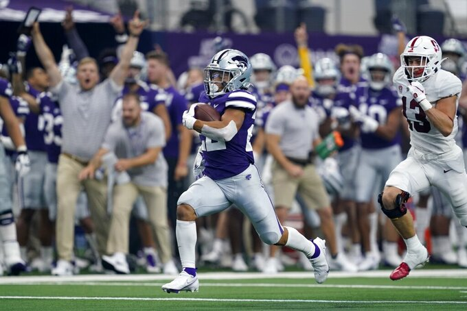 Kansas State running back Deuce Vaughn (22) sprints past Stanford cornerback Ethan Bonner (13) on his way to the end zone for a touchdown in the first half of an NCAA college football game in Arlington, Texas, Saturday, Sept. 4, 2021. (AP Photo/Tony Gutierrez)