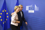 Germany's Ursula von der Leyen is welcomed by European Commission President Jean-Claude Juncker prior to a meeting at EU headquarters in Brussels, Thursday July 4, 2019. European Union leaders have nominated Germany's Ursula von der Leyen to become the next president of the European Commission. (AP Photo/Virginia Mayo)
