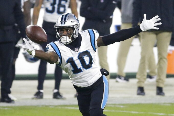 Carolina Panthers' Curtis Samuel can't catch ch a apass during the first half of an NFL football game against the Green Bay Packers Saturday, Dec. 19, 2020, in Green Bay, Wis. (AP Photo/Mike Roemer)