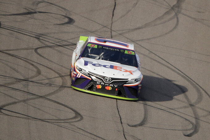 Denny Hamlin drives during a NASCAR Cup Series auto race at Kansas Speedway in Kansas City, Kan. Sunday, Oct. 20, 2019. (AP Photo/Charlie Riedel)