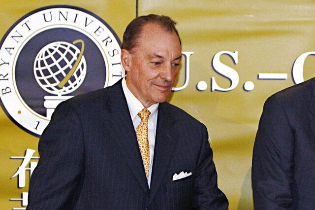 FILE - In this May 17, 2008, file photo, Bryant University President Ronald K. Machtley stands during a ceremony in Smithfield, R.I. An annual study released Tuesday, Jan. 14, 2020, by The Chronicle of Higher Education, finds that average pay for private university chiefs grew by 10.5% in 2017. Machtley's earnings were listed at $6.28 million. (AP Photo/Bizuayehu Tesfaye, File)