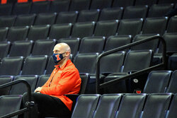 Illinois athletic director Josh Whitman watches the Illini take on North Carolina A&T in the arena empty of fans, during the first half of an NCAA college basketball game Wednesday, Nov. 25, 2020, in Champaign, Ill. (AP Photo/Holly Hart)