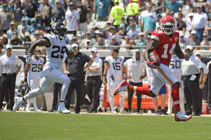 Kansas City Chiefs wide receiver Sammy Watkins, right, outruns Jacksonville Jaguars defensive back D.J. Hayden to the end zone for a 68-yard touchdown on a pass play during the first half of an NFL football game, Sunday, Sept. 8, 2019, in Jacksonville, Fla. (AP Photo/Phelan M. Ebenhack)