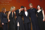 Actresses Benedicte Couvreur, from left, Valeria Golino, Noemie Merlant, director Celine Sciamma, actresses Adele Haenel, and Luana Bajrami pose for photographers upon arrival at the premiere of the film 'Portrait of a Lady on Fire' at the 72nd international film festival, Cannes, southern France, Sunday, May 19, 2019. (Photo by Vianney Le Caer/Invision/AP)