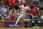Cincinnati Reds' Aristides Aquino scores during the ninth inning of a baseball game against the St. Louis Cardinals Friday, Sept. 10, 2021, in St. Louis. (AP Photo/Jeff Roberson)
