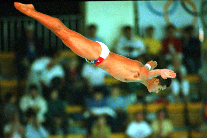 FILE - In this Sept. 26, 1988, file photo, Greg Louganis, of the United States, performs in the men's preliminary 10-meter platform diving competition at the XXIV Summer Olympic Games in Seoul, South Korea.  (AP Photo/Ed Reinke, File)