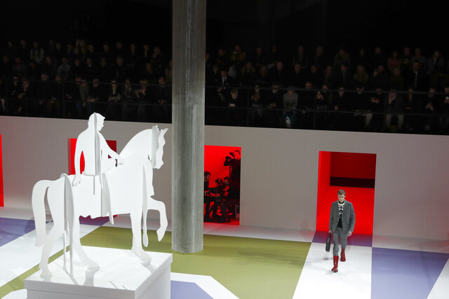 A model wears a creation as part of the Prada men's Fall-Winter 2020/21 collection, that was presented in Milan, Italy, Sunday, Jan. 12, 2020. (AP Photo/Antonio Calanni)