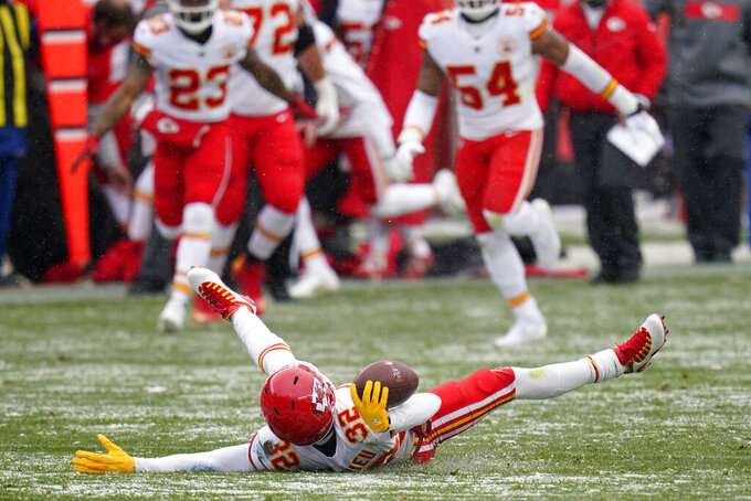 Kansas City Chiefs strong safety Tyrann Mathieu, below, celebrates after picking up a fumble during the first half of an NFL football game against the Denver Broncos, Sunday, Oct. 25, 2020, in Denver. (AP Photo/Jack Dempsey)