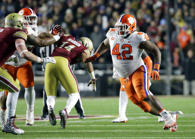FILE - In this Nov. 10, 2018, file photo, Clemson defensive lineman Christian Wilkins (42) rushes in against Boston College in the second half of an NCAA college football game in Boston. Wilkins and the defensive line will lead No. 2 Clemson against Pittsburgh as the Tigers hope to capture a fourth straight Atlantic Coast Conference championship Saturday night. (AP Photo/Elise Amendola, file)