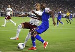 Mexico defender Luis Rodriguez, left, applies pressure on Haiti forward Herve Bazile, right, during the first half of a CONCACAF Gold Cup soccer match Tuesday, July 2, 2019, in Glendale, Ariz. (AP Photo/Ross D. Franklin)