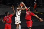 St. John's Julian Champagnie, right, stops a shot-attempt by Boston College's Wynston Tabbs, center, as St. John's Greg Williams Jr., left, defends in the second half of an NCAA college basketball game, Monday, Nov. 30, 2020, in Uncasville, Conn. (AP Photo/Jessica Hill)