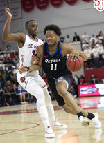 DePaul guard Eli Cain (11) drives to the basket against St. John's guard Mustapha Heron in the first half of an NCAA college basketball game, Saturday, Jan. 12, 2019, in New York. (AP Photo/Mary Altaffer)