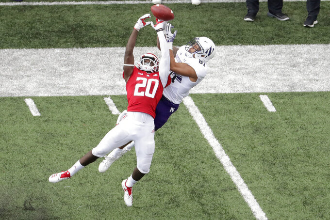 Rutgers defensive back Avery Young (20) deflects a pass intended for Northwestern wide receiver Ramaud Chiaokhiao-Bowman during the second half of an NCAA college football game, Saturday, Oct. 20, 2018, in Piscataway, N.J. Northwestern won 18-15. (AP Photo/Julio Cortez)