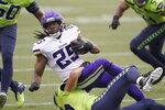Minnesota Vikings running back Alexander Mattison is brought down by the Seattle Seahawks during the first half of an NFL football game, Sunday, Oct. 11, 2020, in Seattle. (AP Photo/Ted S. Warren)