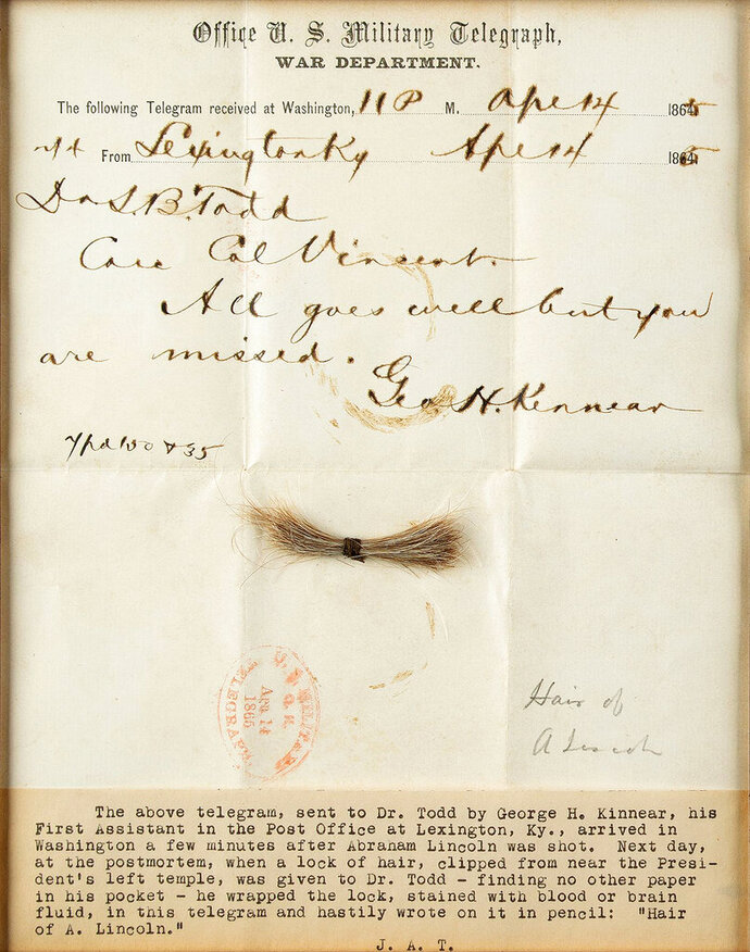 This July 2020 photo released by RR Auction shows a bloodstained telegram and lock of hair from former President Abraham Lincoln, to be auctioned Sept. 12, 2020, by the Boston-based auction firm. The lock of hair was removed during Lincoln's postmortem examination in April 1865 after he was fatally shot by John Wilkes Booth at Ford's Theatre in Washington. (Nikki Brickett/RR Auction via AP)