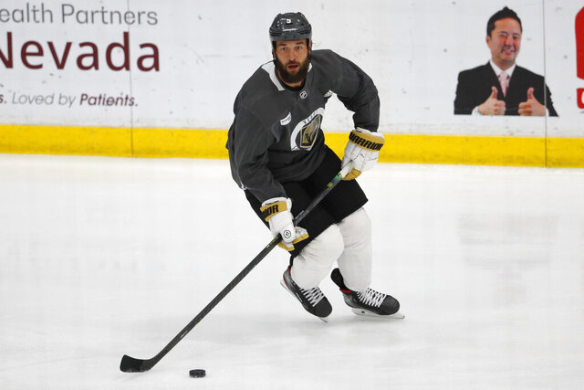 FILE- In this  July 14, 2020, file photo, Vegas Golden Knights defenseman Deryk Engelland (5) skates during NHL hockey summer training camp in Las Vegas. Engelland on Tuesday, Dec. 22, 2020, became the latest NHL veteran to step away from hockey before players report to training camps to prepare for the 2021 season (AP Photo/John Locher, File)