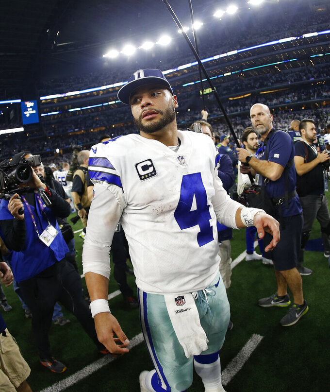 Dallas Cowboys quarterback Dak Prescott leaves the field after the NFC wild-card NFL football game against the Seattle Seahawks, in Arlington, Texas, Saturday, Jan. 5, 2019. The Cowboys won 24-22. (AP Photo/Ron Jenkins)