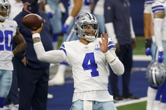 Dallas Cowboys quarterback Dak Prescott (4) throws a pass during warmups before an NFL football game against the New York Giants in Arlington, Texas, Sunday, Oct. 11, 2020. (AP Photo/Ron Jenkins)