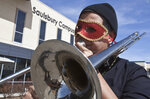 Odessa College student Robert Granado plays the trombone during the cajun food cook-off after a New Orleans style parade Tuesday, Feb. 13, 2017, at the Saulsbury Campus Center in Odessa, Texas. (Jacob Ford/Odessa American via AP)