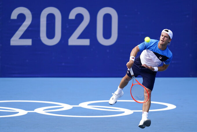 Diego Schwartzman, of Argentina, serves to Tomas Machac, of the Czech Republic, during second round of the men's tennis competition at the 2020 Summer Olympics, Tuesday, July 27, 2021, in Tokyo, Japan. (AP Photo/Patrick Semansky)