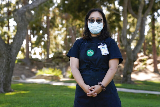 Katie Doan, a former Whole Foods employee, poses for a photo Thursday, July 16, 2020, in Costa Mesa, Calif. Doan started tracking COVID-19 cases at Amazon-owned Whole Foods in April. (AP Photo/Ashley Landis)