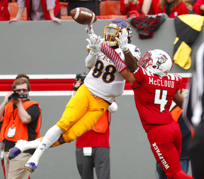 North Carolina State's Nick McCloud (4) blocks a pass intended for East Carolina's Trevon Brown (88) during the first half of NCAA college football game in Raleigh, N.C., Saturday, Dec. 1, 2018. McCloud intercepted the pass as it came back down after the block. (AP Photo/Chris Seward)