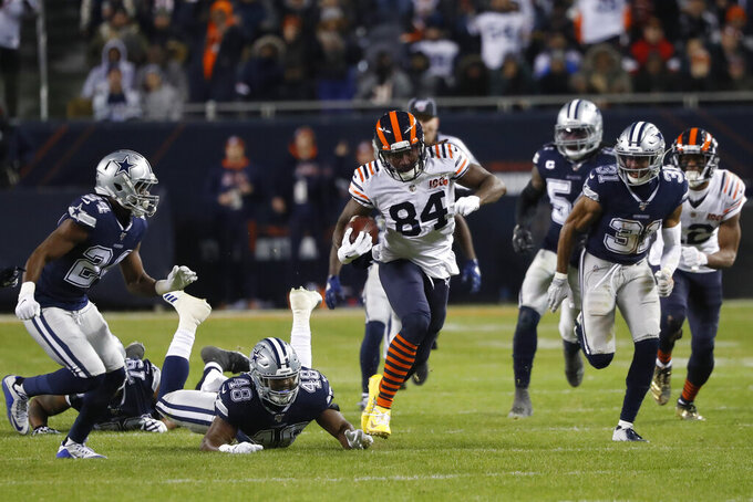 Chicago Bears' Cordarrelle Patterson (84) runs out of a tackle of Dallas Cowboys' Joe Thomas (48) during the second half of an NFL football game, Thursday, Dec. 5, 2019, in Chicago. (AP Photo/Charles Rex Arbogast)