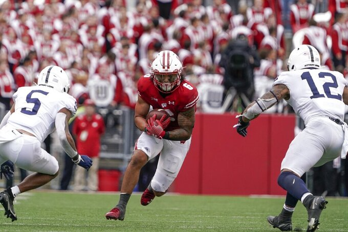 Wisconsin's Chez Mellusi runs during the second half of an NCAA college football game against Penn State Saturday, Sept. 4, 2021, in Madison, Wis. Penn State won 16-10. (AP Photo/Morry Gash)
