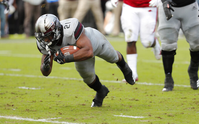 Mississippi State running back Nick Gibson (21) dives into the end zone for a short yardage touchdown against Arkansas during the first half of an NCAA college football game in Starkville, Miss., Saturday, Nov. 17, 2018. (AP Photo/Rogelio V. Solis)