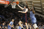 Pennsylvania's AJ Brodeur, center, goes up for a shot past Villanova's Dhamir Cosby-Roundtree during the first half of an NCAA college basketball game Wednesday, Dec. 4, 2019, in Villanova, Pa. (AP Photo/Matt Slocum)