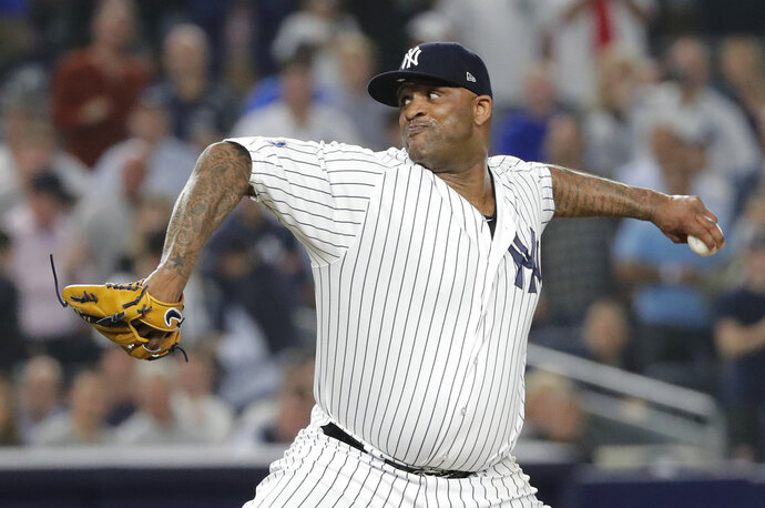 FILE - In this Tuesday, Oct. 9, 2018 file photo, New York Yankees starting pitcher CC Sabathia delivers against the Boston Red Sox during the first inning of Game 4 of baseball's American League Division Series in New York. Yankees pitcher CC Sabathia has been cleared to resume working out, including baseball activities. The 38-year-old left-hander had a blockage in one artery to his heart and underwent a procedure Dec. 11 to insert a stent to clear the blockage. Sabathia had a scheduled follow-up stress test Tuesday, Jan. 8, 2019 according to New York, and was cleared to work out.(AP Photo/Frank Franklin II, File)