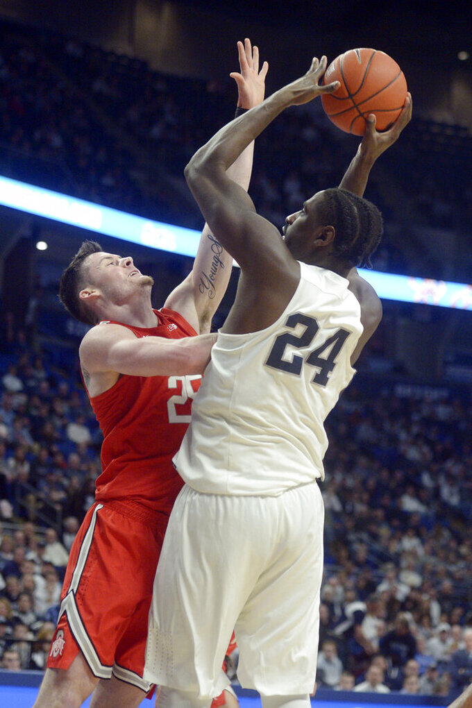 Penn State's Mike Watkins (24) shoots over Ohio State's Kyle Young (25) during first half action of an NCAA college basketball game, Saturday, Jan. 18, 2020, in State College, Pa. (AP Photo/Gary M. Baranec)