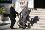 Israeli Prime Minister Benjamin Netanyahu is greeted by Portuguese Prime Minister Antonio Costa, right, as he arrives for their meeting at the Sao Bento palace in Lisbon Thursday, Dec. 5, 2019. (AP Photo/Armando Franca)