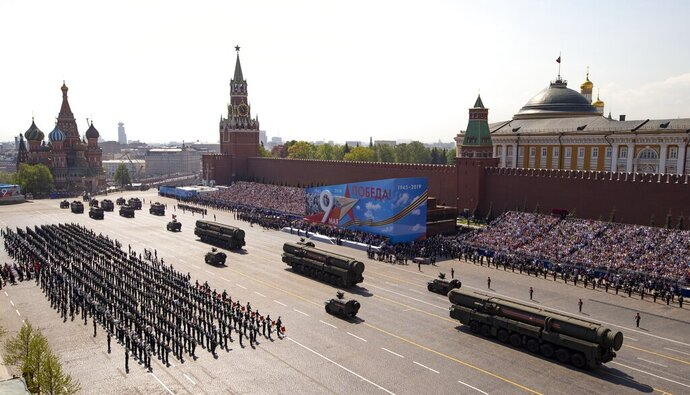 FILE - In this Tuesday, May 7, 2019 file photo, Russian military vehicles roll down Red Square Red Square during a rehearsal for the Victory Day military parade in Moscow, Russia. A massive military parade that was postponed by the coronavirus will roll through Red Square this week to celebrate the 75th anniversary of the end of World War II in Europe, even though Russia is continuing to register a steady rise in infections. (AP Photo/Alexander Zemlianichenko, Pool, File)