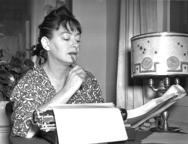 FILE - Dorothy Parker is shown at the typewriter in this Nov. 29, 1941 file photo. A federal judge has ruled. that compiling Dorothy Parker's poems was a far less original act than writing them. The editor of a book of uncollected work by the late author did not show enough