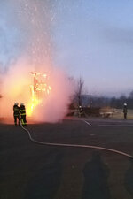 In this photo provided by the municipality of Moravce, firefighters work as wooden sculpture resembling U.S. president Trump is on fire, in Moravce, Slovenia, Thursday, Jan. 9, 2020. The wooden nearly eight-meter high (26 feet) statue mocking U.S. President Donald Trump that was constructed 2019, has been destroyed by fire in the homeland of his wife Melania Trump. (Municipality of Moravce via AP)