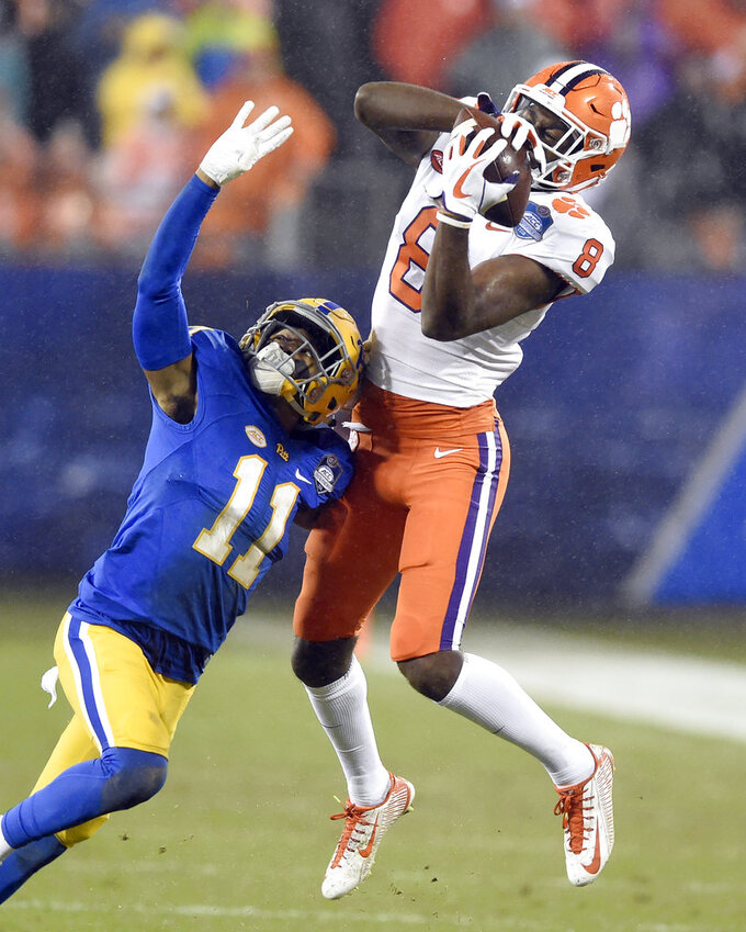 Clemson's Justyn Ross (8) catches a pass as Pittsburgh's Dane Jackson (11) defends in the first half of the Atlantic Coast Conference championship NCAA college football game in Charlotte, N.C., Saturday, Dec. 1, 2018. (AP Photo/Mike McCarn)