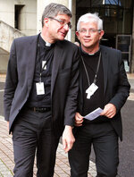 French bishops Olivier Leborgne, right, and Eric de Moulins Beaufort react as they leave a press conference in Lourdes, southwestern France, Saturday, Nov. 9, 2019. 120 bishops are convening for their biannual assembly in Lourdes, where they will discuss the plan for a
