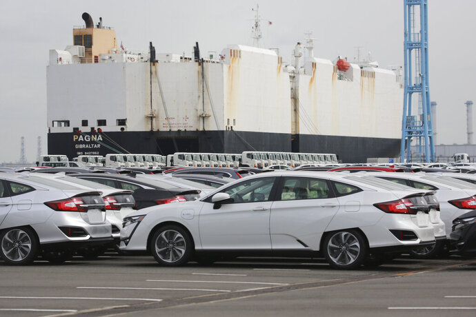 Cars are parked to be exported at Yokohama port, near Tokyo on Sept. 29, 2020. The drop in Japanese exports diminished last month, according to government data released Monday, Oct. 10, 2020, underlining how the blunt of the trade damage from the coronavirus pandemic may be gradually easing.  (AP Photo/Koji Sasahara)