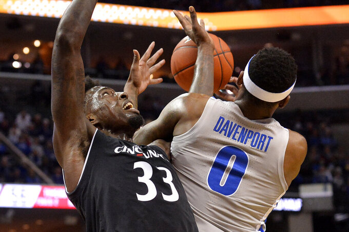 Cincinnati center Nysier Brooks (33) and Memphis forward Kyvon Davenport (0) struggle for control of the ball in the second half of an NCAA college basketball game Thursday, Feb. 7, 2019, in Memphis, Tenn. (AP Photo/Brandon Dill)