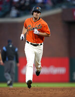 San Francisco Giants' Alex Dickerson runs the bases after hitting a solo home run against the St. Louis Cardinals during the third inning of a baseball game in San Francisco, Friday, July 5, 2019. (AP Photo/Tony Avelar)