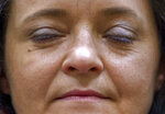 Suspect Beate Zschaepe closes her eyes when she waits for the verdict in the court in Munich, southern Germany, Wednesday, July 11, 2018.  The court found the main defendant in the high-profile neo-Nazi trial guilty over the killing of 10 people _ most of them migrants _ who were gunned down between 2000 and 2007 in a case that shocked Germany and prompted accusations of institutional racism against the country's security agencies. (Peter Kneffel/pool photo via AP)
