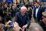 Democratic presidential candidate Sen. Bernie Sanders, I-Vt., greets member of the audience after speaking at a campaign stop at St. Ambrose University, Saturday, Jan. 11, 2020, in Davenport, Iowa. (AP Photo/Andrew Harnik)