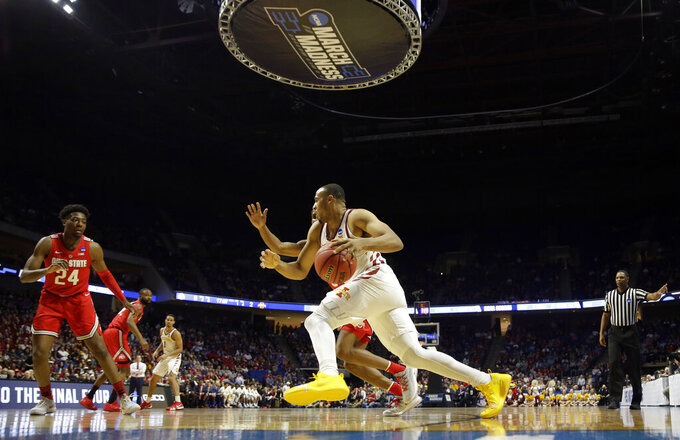 Iowa State's Talen Horton-Tucker, right, heads to the basket as Ohio State's Andre Wesson (24) defends during the first half of a first round men's college basketball game in the NCAA Tournament Friday, March 22, 2019, in Tulsa, Okla. (AP Photo/Jeff Roberson)