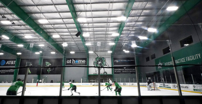 The Dallas Stars run drills during NHL hockey training camp practice Wednesday, Jan. 6, 2021, in Frisco, Texas. (AP Photo/LM Otero)