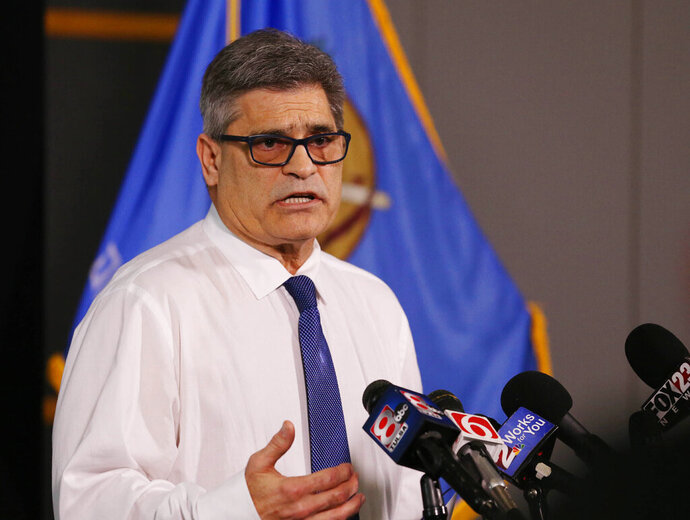 FILE - In this March 17, 2020, file photo, Tulsa Health Department director Dr. Bruce Dart takes part in a news conference about local response to the coronavirus pandemic in Tulsa, Okla. The department said Tuesday, April, 7, 2020, that 67 Oklahomans have now died and 1,472 have tested positive for the virus. Dart said he is