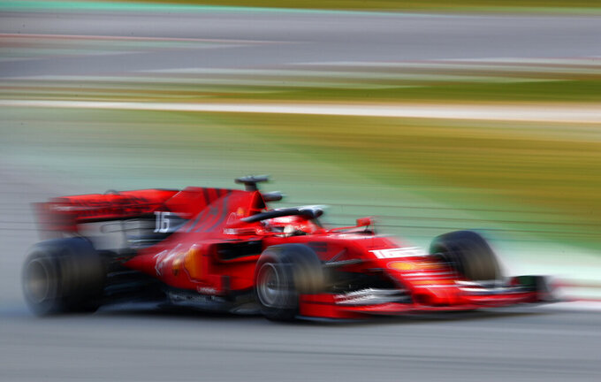 Ferrari driver Charles Leclerq of Monaco steers his car during a Formula One pre-season testing session at the Barcelona Catalunya racetrack in Montmelo, outside Barcelona, Spain, Tuesday, Feb.19, 2019. (AP Photo/Manu Fernandez)