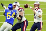 New England Patriots quarterback Jarrett Stidham (4) throws against the Los Angeles Rams during the second half of an NFL football game Thursday, Dec. 10, 2020, in Inglewood, Calif. (AP Photo/Ashley Landis)