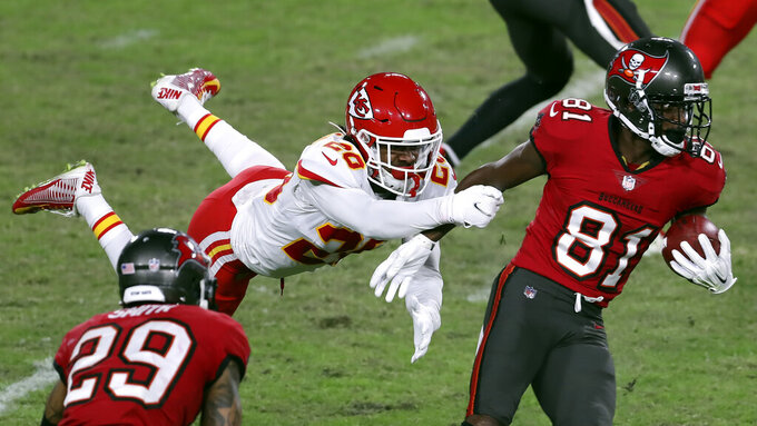Kansas City Chiefs cornerback Antonio Hamilton (20) flies through the air as he tries to stop Tampa Bay Buccaneers wide receiver Antonio Brown (81) during the second half of an NFL football game Sunday, Nov. 29, 2020, in Tampa, Fla. (AP Photo/Mark LoMoglio)