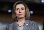 Speaker of the House Nancy Pelosi, D-Calif., stands during a news conference on climate change at the Capitol in Washington, Friday, Dec. 6, 2019. House Democrats are moving swiftly to draw up articles of impeachment against President Donald Trump, with Pelosi saying Trump abused his power in the Ukraine matter and violated the Constitution, insisting the president